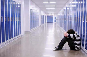 kid-alone-in-school-hallway
